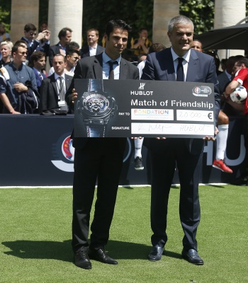 Ricardo Guadalupe, Hublot CEO (L) gives a cheque to Cyril Pellevat, Representative of the Foundation for the Children of the UEFA during the football match of friendship with Pelé and Maradona sponsored by Hublot in Paris, France on 9th of June 2016.