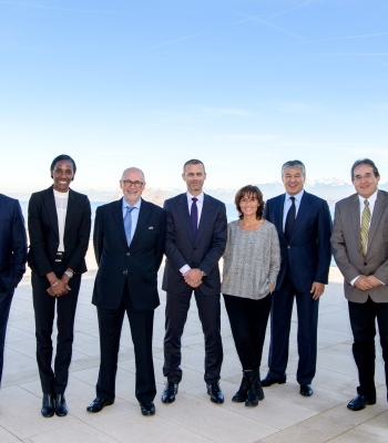 NYON, SWITZERLAND - NOVEMBER 22:  UEFA Foundation Board members Kevin Lamour, Fiona May, Peter Gillieron, Aleksander Ceferin, Nathalie Iannetta, Kairat Boranbayev and Norman Darmanin Demajo pose for a group photo prior to their meeting at the UEFA headquarters, the House of European Football on November 22, 2017 in Nyon, Switzerland. (Photo by Harold Cunningham - UEFA/UEFA via Getty Images)