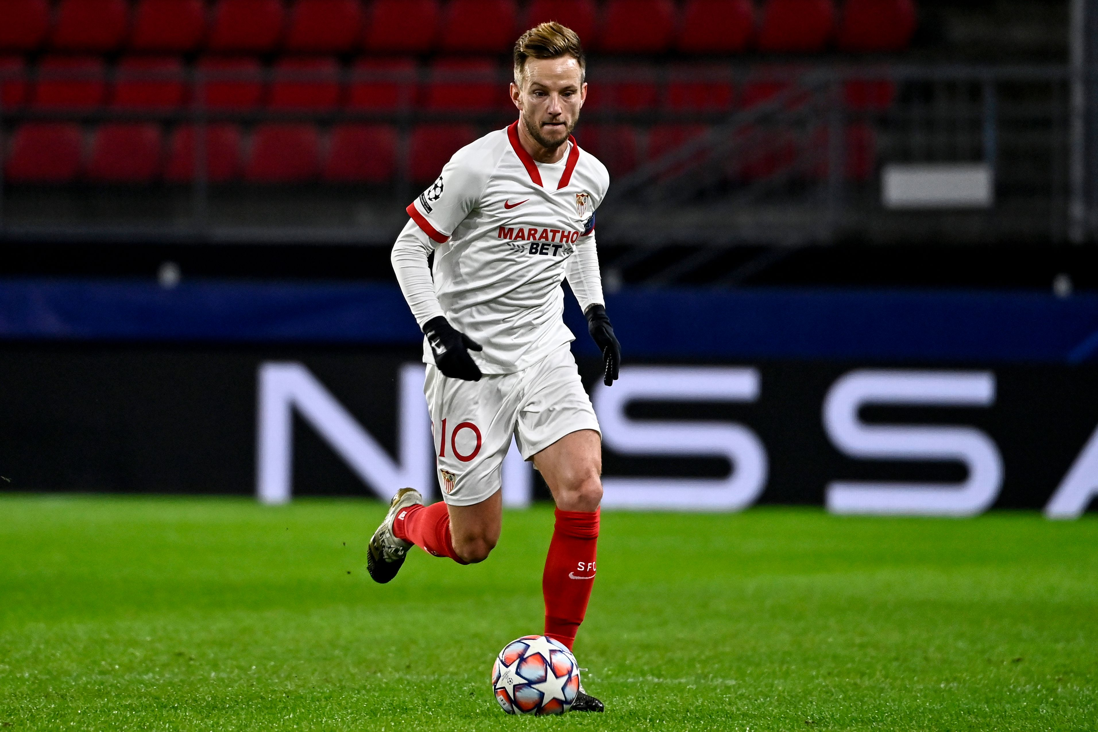 Sevilla's Croatian midfielder Ivan Rakitic runs with the ball during the UEFA Champions League Group E football match between Stade Rennais FC and Seville FC, at the Roahzon park stadium in Rennes, western France, on December 8, 2020. (Photo by DAMIEN MEYER / AFP) (Photo by DAMIEN MEYER/AFP via Getty Images)